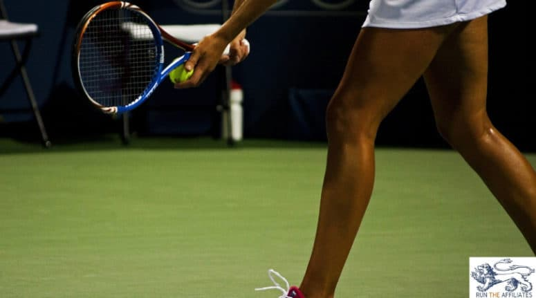 female tennis player about to serve