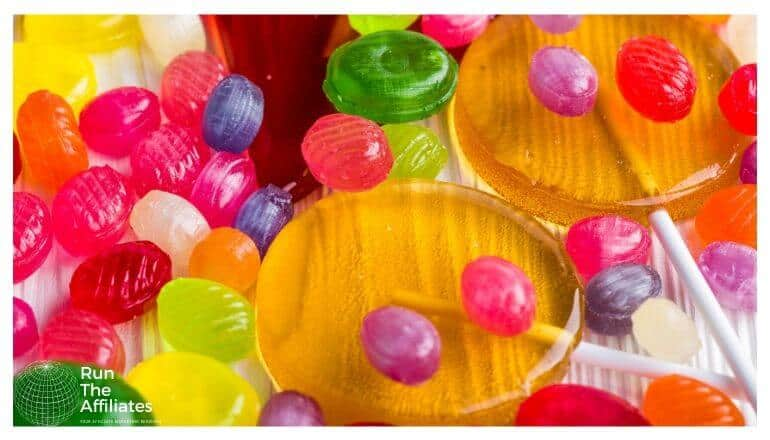 jelly beans and lollipops on a table