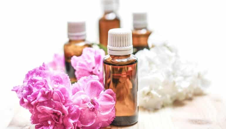 essential oils and flowers on a table