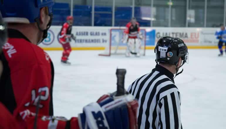 hockey player behind ref