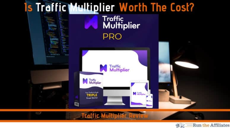 monitors on a table behind the traffic multiplier logo