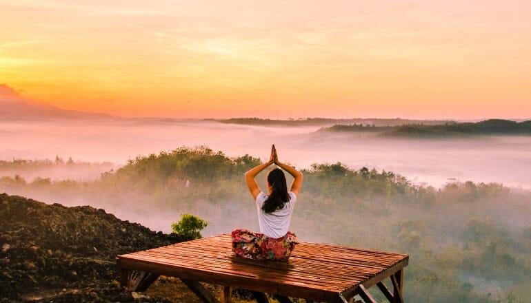 woman meditation on mountain