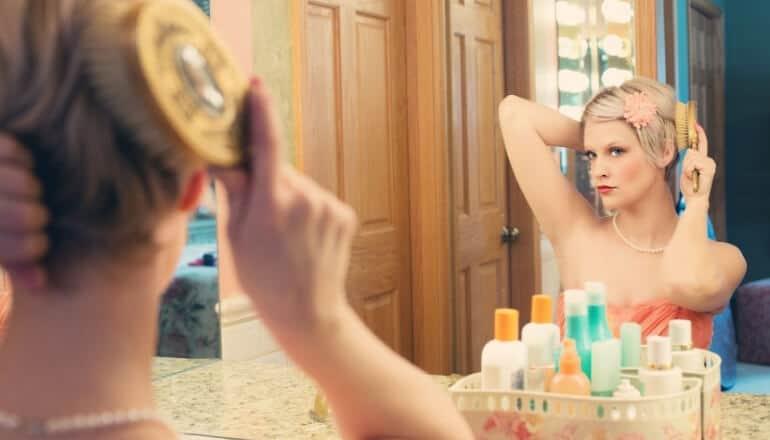 woman brushing here hair