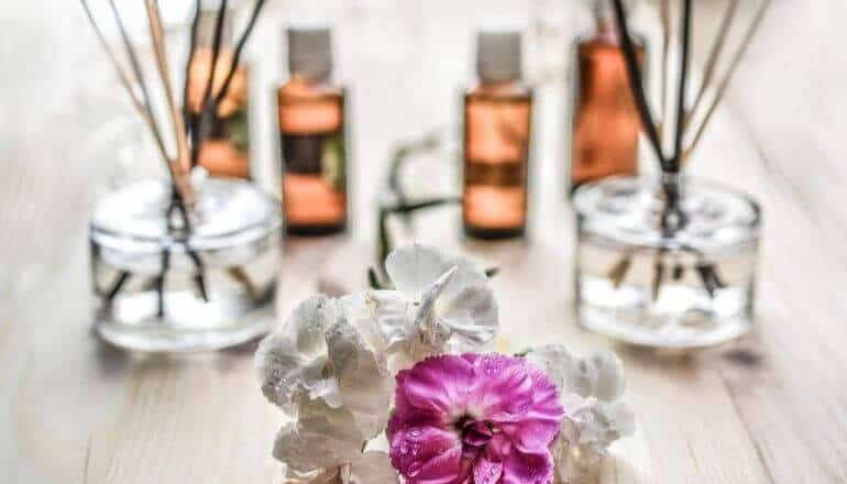 essential oils and flower on a table