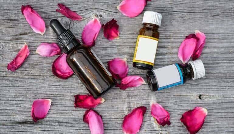 3 essential oils and flower petals