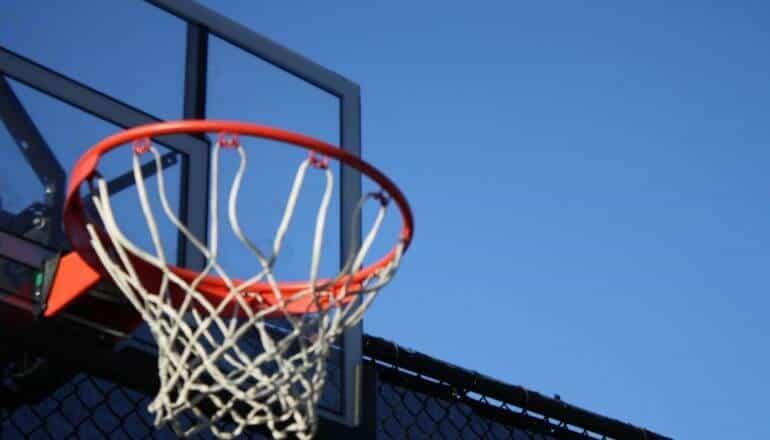 basketball hoop against a blue sky