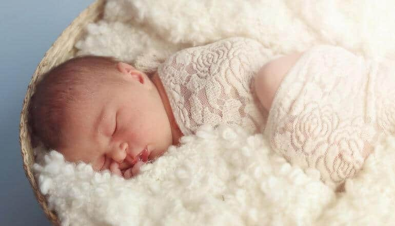 baby in a blanket sleeping