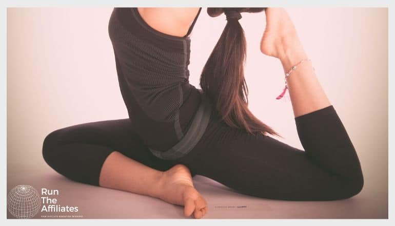 woman in activewear stretching while doing yoga