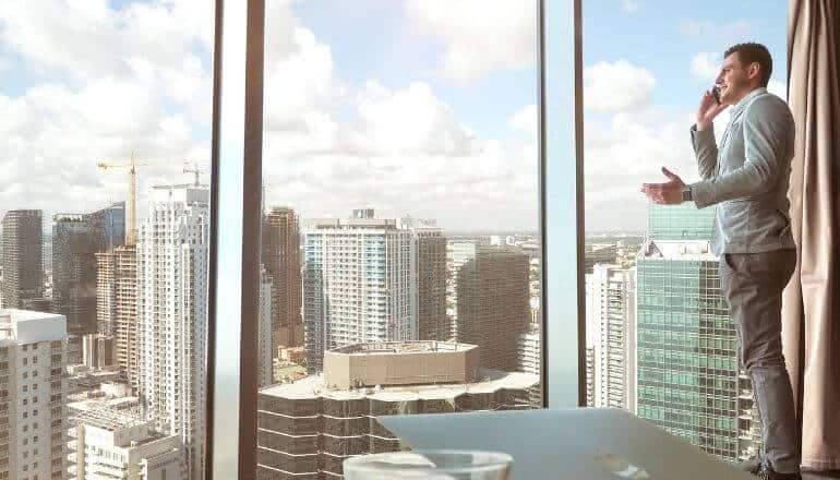 boss looking out office window