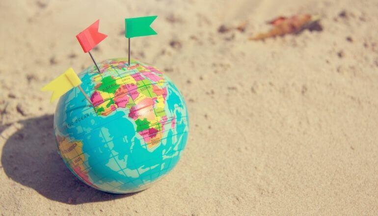 toy globe on the beach