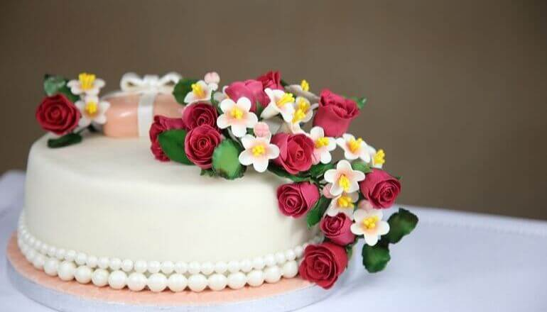 cake decorated with candy roses