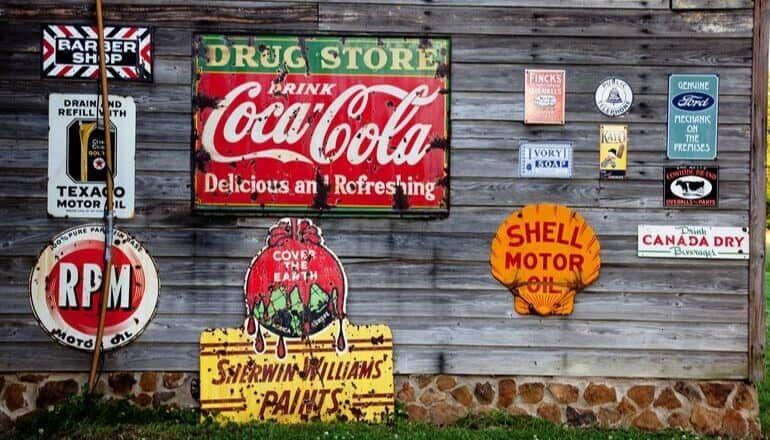 ads and signs on a wood wall