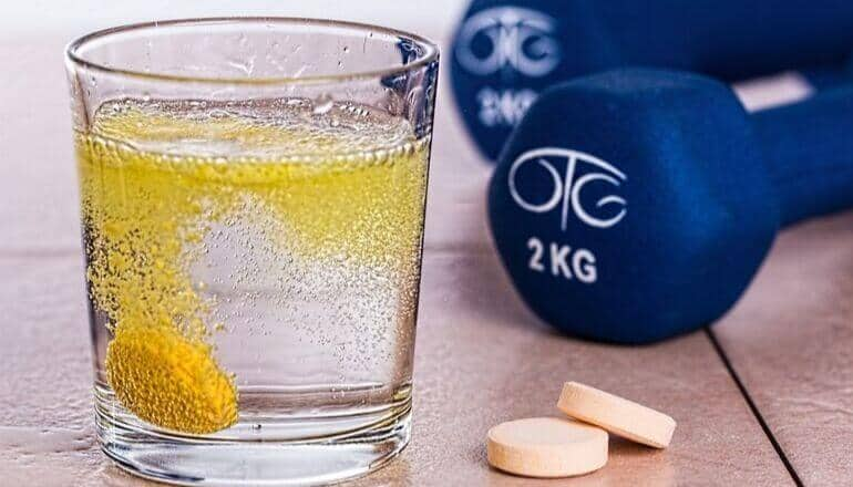supplements and weights on a table