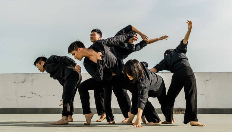 men in black dancing