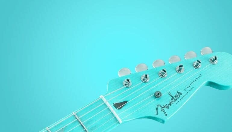 light blue fender guitar