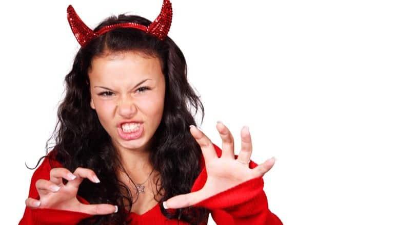 woman dressed as devil
