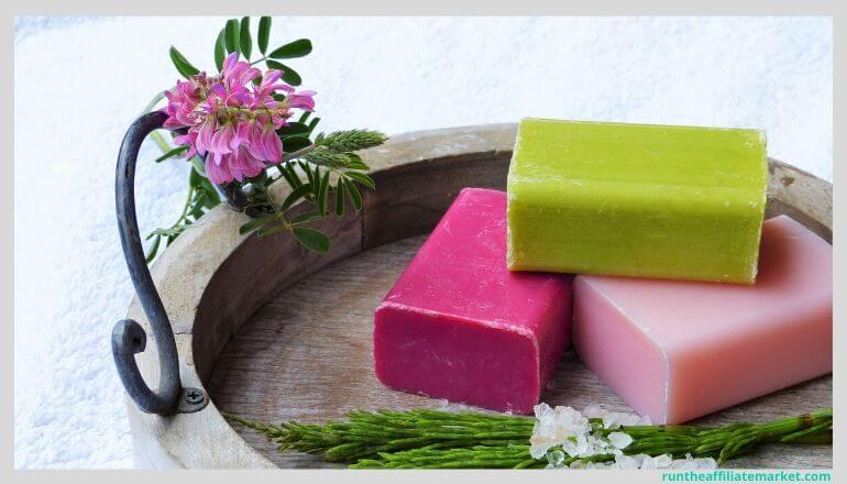 multicolored bars of soap in a wooden tray