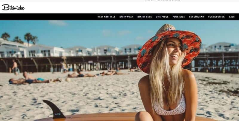 screenshot of a woman on a beach in a bikini on the bikinishe webpage