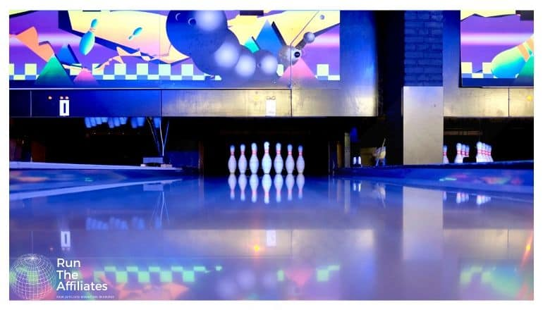 bowling alley lit with purple light