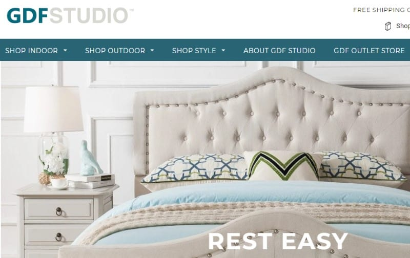 screenshot of the gdf studio website featuring a white bed and bedroom set