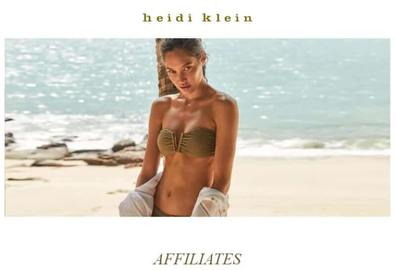 screenshot heidi klein affiliate website featuring a woman in a brown bikini on the beach