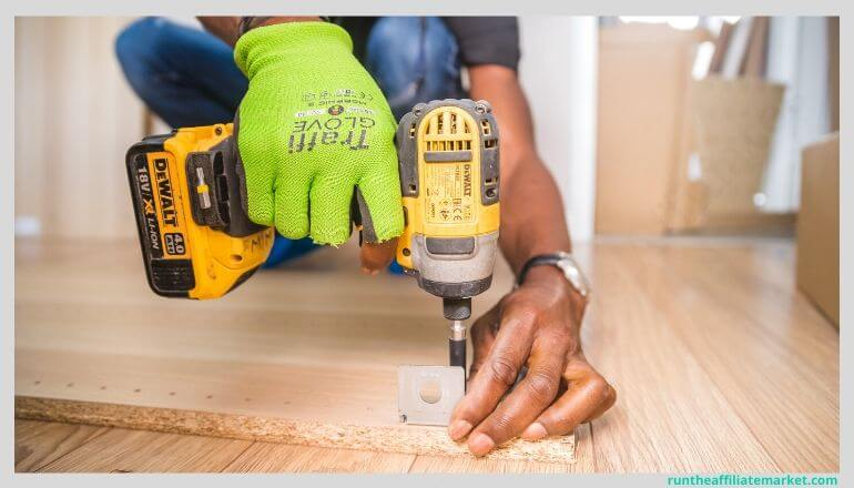dewalt power drill being used to drill a piece of wood