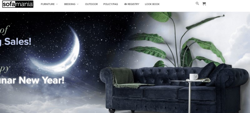 screenshot of the sofa mania website featuring a blue sofa with green blankets adorning it