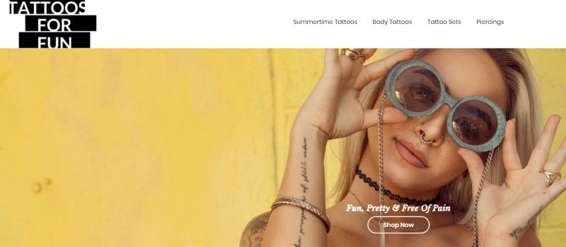 screenshot of the tattoos for fun website featuring a blonde model with temporary tattoos and wearing sunglasses