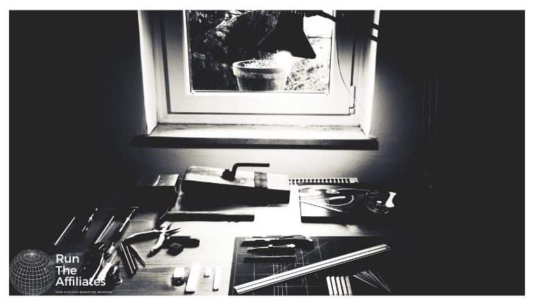 workbench with various woodworking tools on it, photo is in black and white