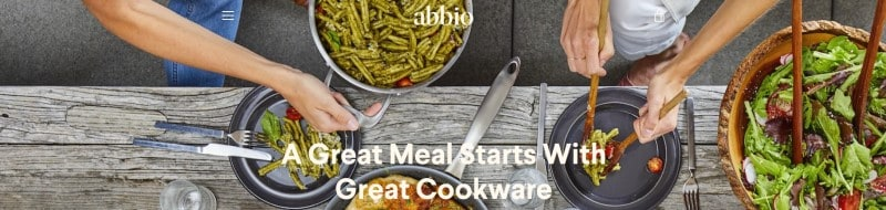screenshot of the abbio website featuring a group of people preparing a meal