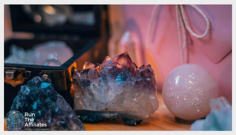 healing crystals on a desk next to a small jewelry box