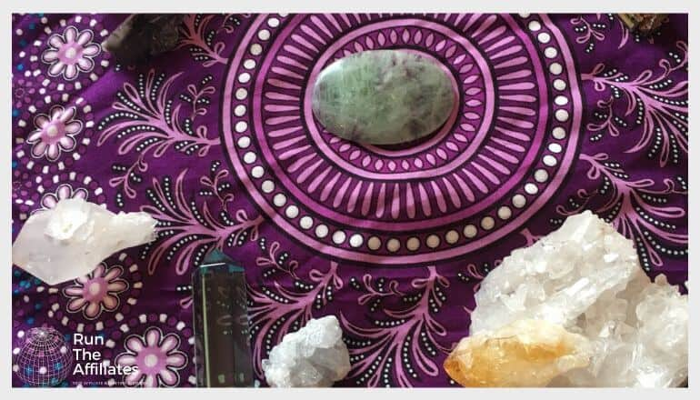 healing crystals on an ornate purple cloth