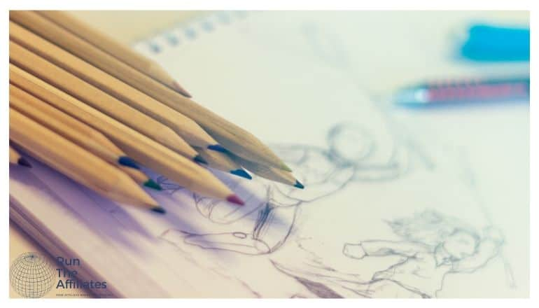 colored pencils resting on a drawing