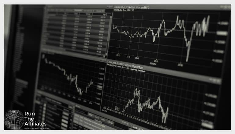 computer monitor with Forex infomraion, charts and graphs in black and white