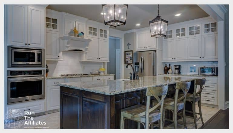 kitchen with marble counter tops and an island with chairs around it