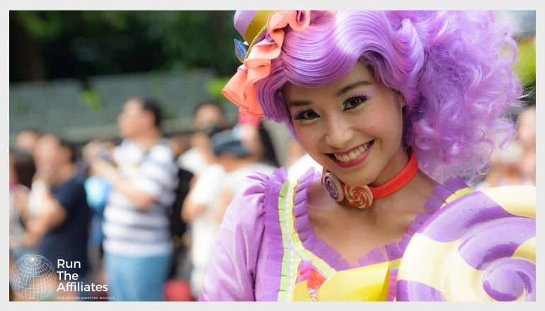 woman in purple wig smiling at the camera