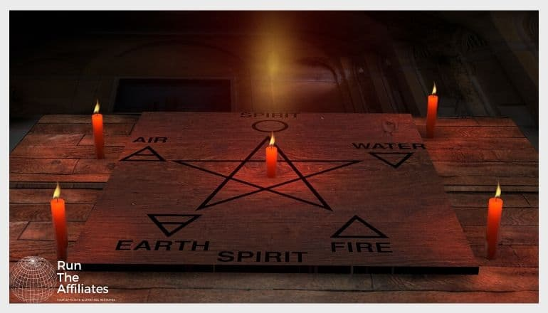 pentagram on the ground with candle at each point