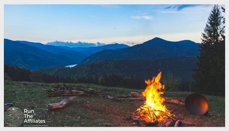 campfire against a pictureque mountain backdrop