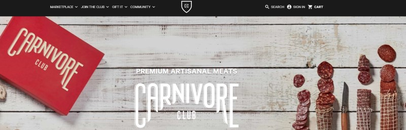screenshot of carnivore club website featuring a reb box and cured sliced artisan meats next to a knife