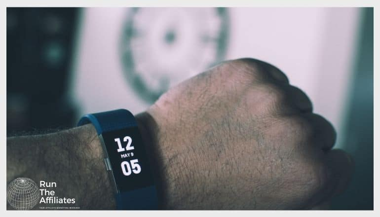 close up image of a fitness tracker on a mans arm