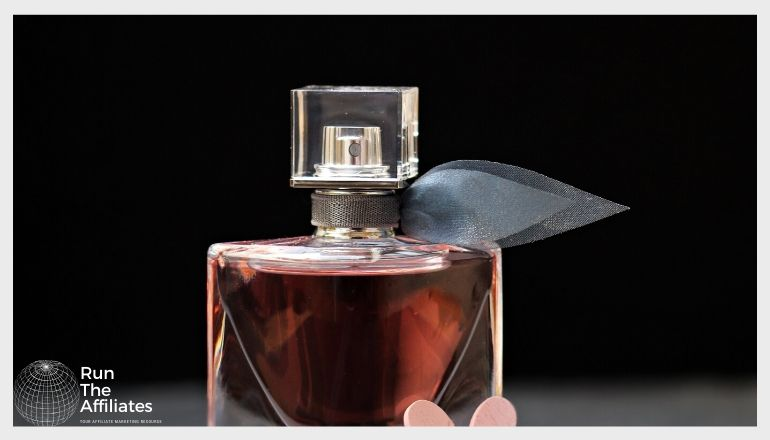 bottle of perfume against a black background
