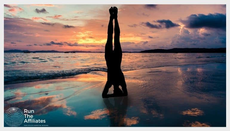 woman in a yoga pose on the beach