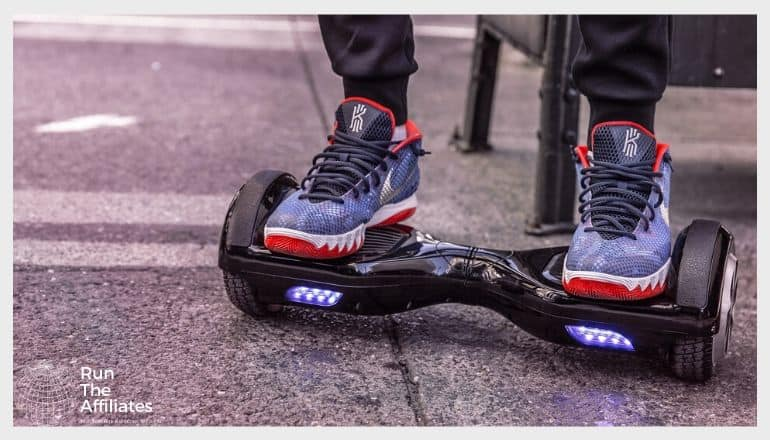 man in red white and blue sneakers on a hoverboard