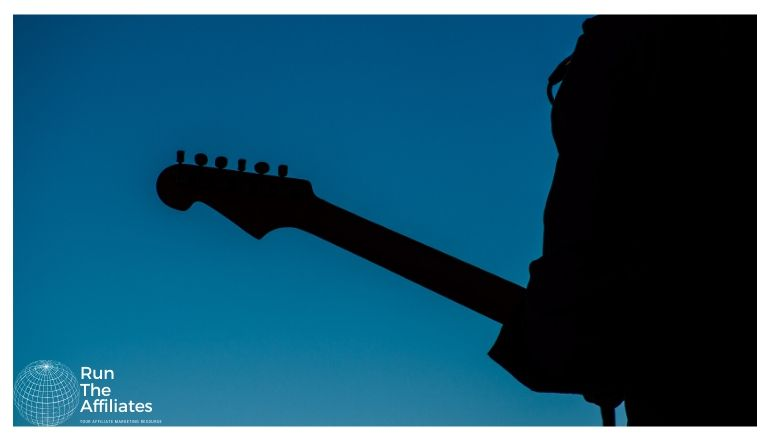 silhouette of a man with a guitar