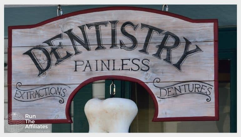 wooden dentistry sign