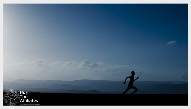 man running silouhetted against the horizon