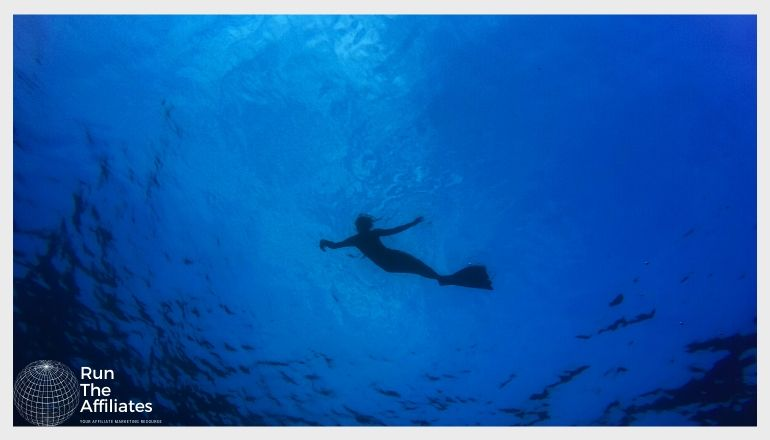 scuba diver in a deep blue sea