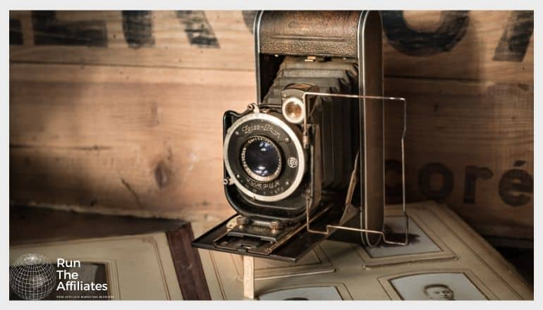 antique camera resting on a vintage photo album