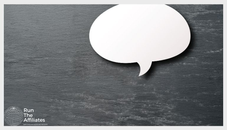 chat bubble against a dark wooden background