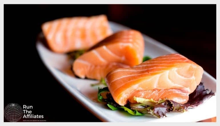 plate with raw salmon fillets on it